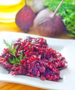 Fresh salad with beet and walnuts on white plate Stock Photos