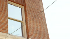 Establishing shot of a brick building Stock Footage