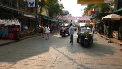POV walk along Khaosan road famous backpacker ghetto, cheap accommodation, shops - stock footage