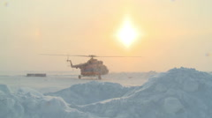 Helicopter MI-8 is ready to take off in the Far North Stock Footage