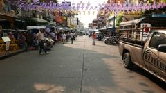 Sunny afternoon Khao San road, POV camera walk through, street marketing Stock Footage