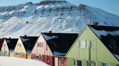 A small town in the far north of Europe among the snow-capped mountains. - stock footage