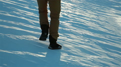 The man cautiously goes on the slippery ice crust in winter. Stock Footage