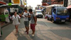 POV walk along Khao San road, garments stalls, tourist, motorbike, tuk-tuk Stock Footage