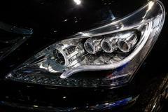 Closeup headlights of car.modern light element - stock photo