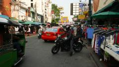 Two police man on black motorcycle drive out from passage to Khaosan road Stock Footage