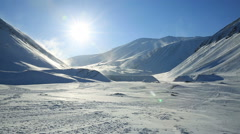 Snowmobile ride on the background of a sunny snowy landscape. Stock Footage
