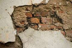 Eroded Textured Stucco Vintage Colonial Wall  in Asia with multiple Materials Stock Photos