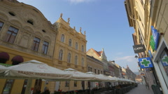 Beautiful building and an outdoor restaurant on Republicii street, Brasov Stock Footage