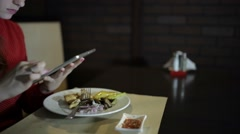 Beautiful girl works with the tablet at the table cafe. Stock Footage
