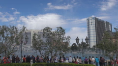 Tourist people enjoy Bellagio fountain water show Las Vegas day tourism emblem Stock Footage