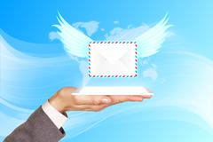 Projection the mail with wings from mobile Stock Photos