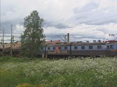 Ore transport on the ore railway in urban area Gallivare, Sweden Stock Footage
