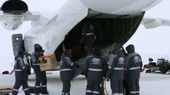 Members of polar expedition discharged equipment and gear of the plane. Stock Footage