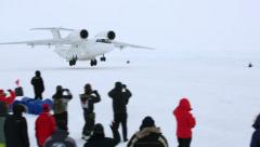 Plane takes off from ice floe near the North Pole. Stock Footage