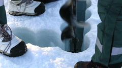 Polar scientists drilled a hole in the ice to take samples of sea water. Stock Footage