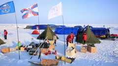 Members of polar expedition unpack the scientific equipment and gear. - stock footage