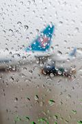 Water drops on an aircraft window Stock Photos
