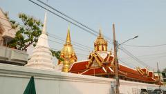 Buddhist temple stupas and gable roofs truck shot, seen from outside enclosure - stock footage