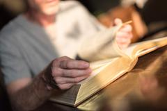 Man reading the Bible - stock photo