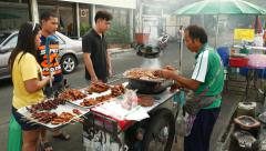 Vendor cart offering meals on skewers, barbecue meat and chicken Stock Footage