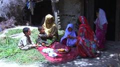 Women feeding children Stock Footage