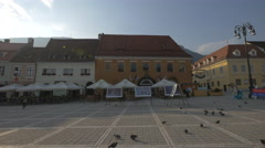 Kids running after pigeons in Council Square, Brasov Stock Footage