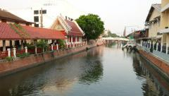 City canal, high decorated pedestrian area on bank, traditional style Stock Footage