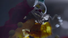 Surreal dizzying footage of toy clown Stock Footage