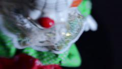 Surreal dizzying overhead shot of toy clown Stock Footage