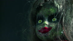 Creepy doll stares into the distance - stock footage