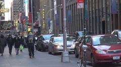 Traffic street Manhattan downtown tourist people walk sidewalk New York City day Stock Footage