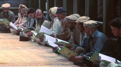 Men Reciting quran - stock footage