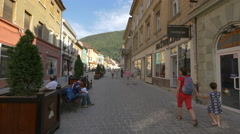 Mother with a girl walking on Michael Weiss street, Brasov Stock Footage