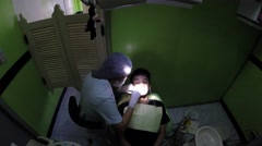 Stock Video Footage of Dentist Placing Braces For Crooked Teeth to young man