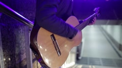 Close-up guitar. Man playing in the underground passage Stock Footage