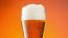 Glass of light beer in slide motion Stock Footage