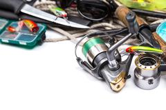 Fishing tackles and anchor with cord on white Stock Photos