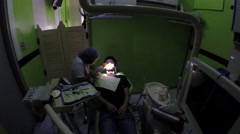 Curing Dental Inlays With UV Light equipment - stock footage