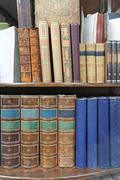Stock Photo of Collection of Antique Books at Book Shelf
