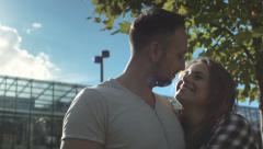 Beautiful couple in love tenderly embracing during sunny day. Stock Footage
