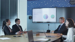 Team Of Office Workers Have Conversation in Conference Room. - stock footage