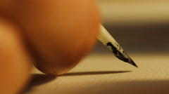 Close up shot of man writing with quill pen Stock Footage