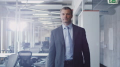 Businessman walking through Office. Stock Footage