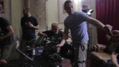 Preparation for filming. Replacing lenses on a movie camera. Film shooting - stock footage