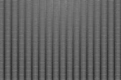 Dark aluminium embossed sheet vector background of columns of embossed shapes Stock Illustration