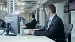 Two Workers are Working and Chatting in Workplace in Office Stock Footage