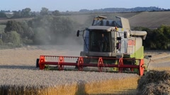 combine harvester harvesting wheat grain barwick in elmet united kingdom - stock footage