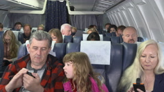 Passengers on aircraft using inflight wifi Stock Footage