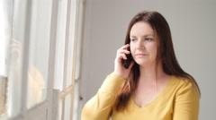Caucasian brunette woman talking, phone, business conversation Stock Video 4K Stock Footage